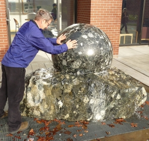 "Whatcom Community College instructor Doug McKeever rotates the ""Levitating Sphere"", made from the Donovan Avenue Erratic."