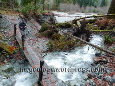 John Scurlock at the Lake Creek foot gbridge. The stream has cut down into its own fan.