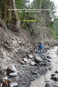 The 'hihg-mud mark' from the glacial outburst flood and debris flow is 20 feet above Bob's head. Click to enlarge.