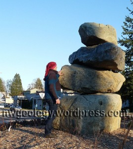 Some guy in a funny hat looks at the giant rock cairn in the roundabout. Hey! Wait I think I know that guy! Where're the cats?