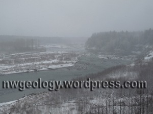 View up river from top of Clay Banks in a snowstorm. Landslide toe in river is at right center. Photo by D. Tucker. Click to enlarge photos.
