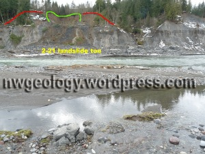 Red line marks scarp of Feb 21 landslide. A later, undated slide is outlined in green. The second slide send brown soil over the top of the earlier clayey slide.