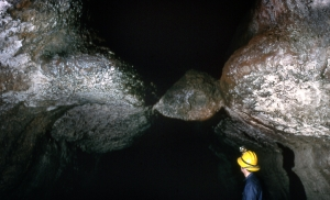 The Meatball is a basalt boulder wedged between the walls of Ape Cave. Photo by Gene Kever.