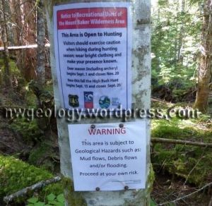 Debris flow warning sign at the Ridley Creek trail head. Placed by US Forest Service after two dangerous debris flows filled the Nooksack's channel with deep mud and large boulders.