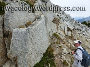Weathering pockets in Hidden Lakes stock granodiorite below the lookout. That's my pal Scott Linneman puzzling over this feature.